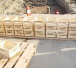 Brandveilig maken houten kratten schiphol
